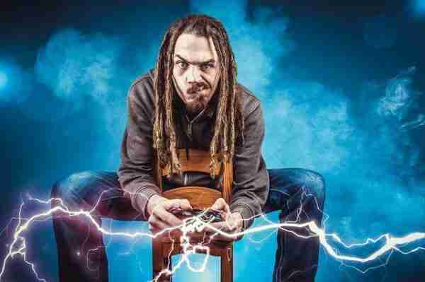man with dreads playing video game, sparks flying